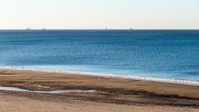 Frozen beach near shipyard and sea port Stock Photos