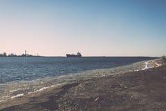 Frozen beach near shipyard and sea port - vintage retro effect Stock Images