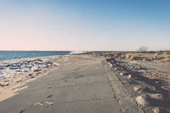 Frozen beach near shipyard and sea port - vintage retro effect Stock Image