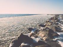 Frozen beach near shipyard and sea port - vintage retro effect Stock Photos
