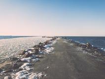 Frozen beach near shipyard and sea port - vintage retro effect Royalty Free Stock Photography