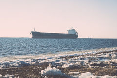 Frozen beach near shipyard and sea port - vintage retro effect Royalty Free Stock Photos