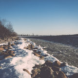 Frozen beach near shipyard and sea port - vintage retro effect Stock Photography