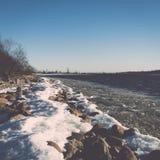 Frozen beach near shipyard and sea port - vintage retro effect Stock Photography