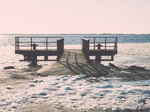 Frozen beach near shipyard and sea port - vintage retro effect Stock Image