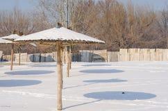 Frozen beach. Snow on the sand and parasol. Novi Sad, Serbia. Royalty Free Stock Images