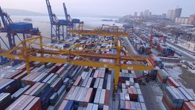 Russia Far East Vladivostok Seaside commercial port terminal. Transport logistics center. Winter cold day. Snow steel containers. Frozen beautiful Russia Far stock video footage