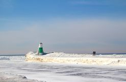 The Frozen Beauty of Lake Michigan. A beautiful blue sky contrasts with the frozen, snowy, white landscape of Lake Michigan. The scene shows a ice and snow stock photos