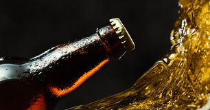 Frozen beer bottle. On a black background stock photos