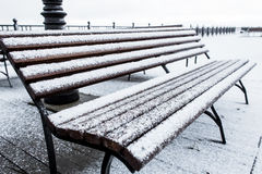 Frozen bench covered gritty rough hoarfrost on a cloudly winter day Royalty Free Stock Photos