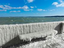 Frozen bench with ice crust Stock Photos