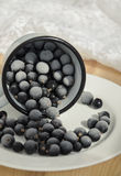 Frozen berries. Frozen black currant in a mug Royalty Free Stock Photos