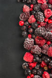 Frozen berries, border food background. With copy space Royalty Free Stock Image