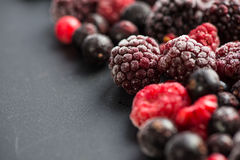 Frozen berries, border food background Stock Photo