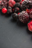 Frozen berries, border food background Royalty Free Stock Photo