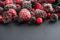 Frozen berries, border food background Royalty Free Stock Images