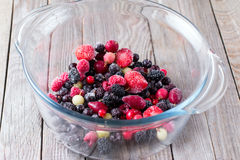 Frozen berries in a glass bowl Stock Photos