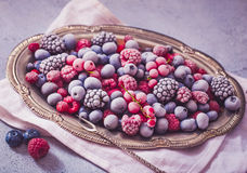Frozen berries in vintage tray royalty free stock image