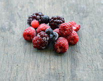 Frozen berries on wooden background Stock Photo