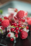 Frozen berries on wooden table Stock Photography