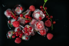 Frozen berries on wooden table Royalty Free Stock Photos