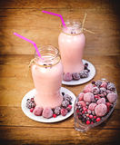 Frozen berry fruits (frozen fruits) and fruit yogurt Royalty Free Stock Images