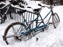 Frozen Bicycle. Image of a bicycle parked, on a public rack, surrounded by ice and snow in Burlington, Vermont Royalty Free Stock Photography