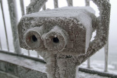 Frozen Binoculars. Coin operated binoculars for observation  covered by snow in winter Stock Photos