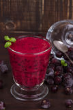 Frozen black currant berries smoothie with mint. royalty free stock photo