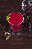 Frozen black currant berries smoothie with mint. royalty free stock images