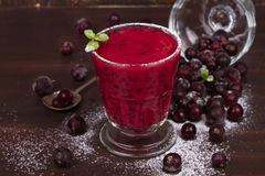 Frozen black currant berries smoothie with mint. Frozen black currant berries smoothie with mint royalty free stock photo
