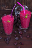 Frozen black currant milkshakes with mint. Stock Image