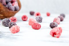 Frozen black and red raspberries in coconut bowl. Frozen black and red raspberries in coconut bowl Stock Photography