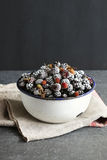 Frozen blackberry on an enamel bowl Royalty Free Stock Photos