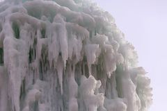 Frozen blocks of ice stalactites Royalty Free Stock Photo
