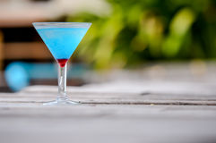 Frozen Blue Margarita Cocktail, blue cocktail on the wooden table Stock Images