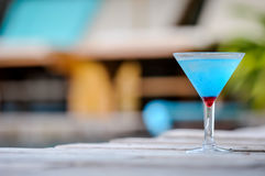 Frozen Blue Margarita Cocktail, blue cocktail on the wooden table Royalty Free Stock Images