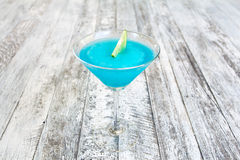 Frozen Blue Margarita Cocktail in martini glass Royalty Free Stock Photography