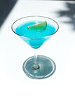 Frozen Blue Margarita Cocktail in martini glass Royalty Free Stock Images
