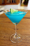Frozen Blue Margarita Cocktail in martini glass Royalty Free Stock Photo