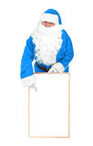 Frozen blue santa and empty white board Royalty Free Stock Photo