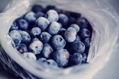 Frozen blueberries in plastic bag Stock Photos