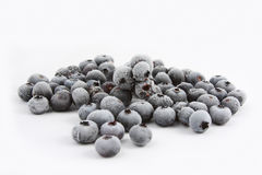 Frozen Blueberries on white background. A bunch of frozen blueberries removed from the freezer on white background Royalty Free Stock Photo