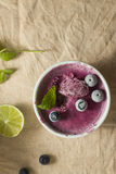 Frozen blueberry yoghurt. With mint leaves and lime stock photography