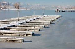 Frozen boat harbor. Utah Lake boat Harbor in Winter stuck in the  ice Stock Photo