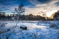 Frozen boat on the lake at sunrise Stock Photography