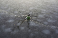 Frozen bottle inside an ice. stock photo