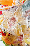 Frozen bouquet of orange flowers Royalty Free Stock Images