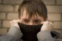 Frozen boy. Trying to warm his nose royalty free stock photography