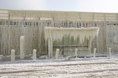 Frozen breakwater and bus stop after winter storm Stock Image